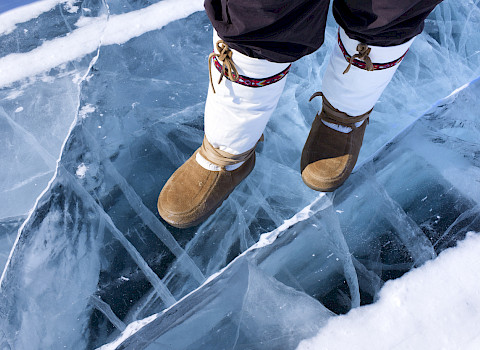 Traditional boots on ice